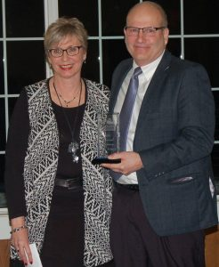 AAESA Superintendent, Mark Dobias, receives the Education Professional award from PNC Manager, Deb Heather.